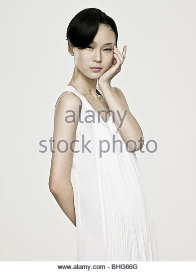 Young asian woman touching her eye - Stock Image
