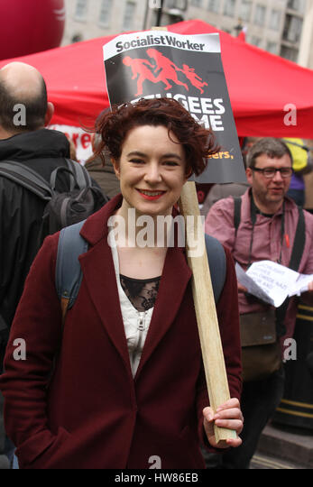 London, UK. March 18, 2017: A demonstrator with a 'socialist Worker' plcards seen ahed of the  Stand Up - Stock Image