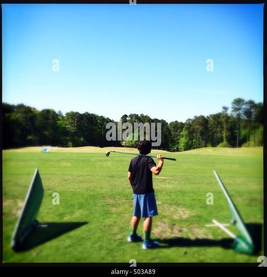 Little boy at driving range - Stock Image