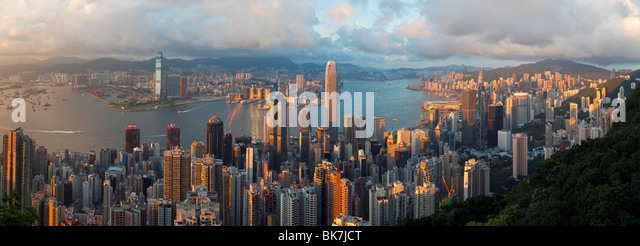 Panoramic view with the illuminated skyline of Central below The Peak, seen from Victoria Peak, Hong Kong, China, - Stock Image