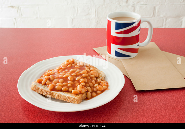 Beans on toast and tea - Stock Image