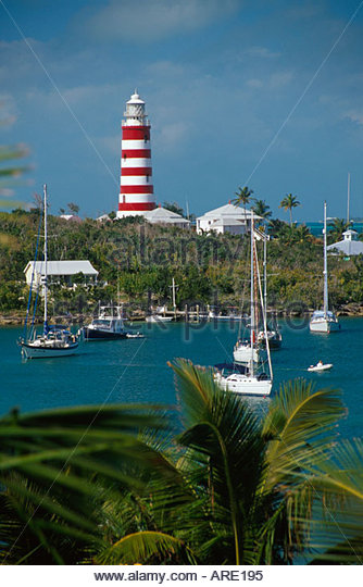 Bahamas Elbow Cay Hope Town Harbour Elbow Reef Lighthouse palms boats - Stock Image