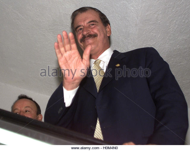 Mexican President Vicente Fox waves as he leaves an event in a Mexico City Hotel, April 23, 2002. Fox was deeply - Stock Image