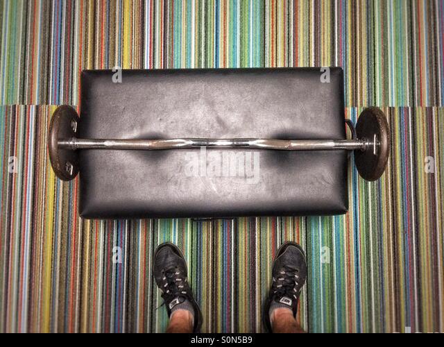 Man before barbell at gym - Stock-Bilder