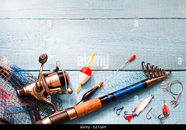 Fishing tackle on wooden blue background closeup - Stock-Bilder