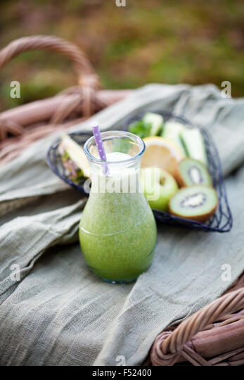 Homemade green juice made from fresh fruit and vegetable - Stock Image