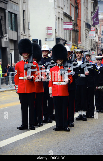 Guardsmen and Sailors stand to attention on the route of Margaret Thatcher's Funeral, London, April 17th 2013 - Stock Image