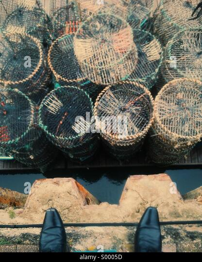 Looking down at fishing equipment - Stock Image