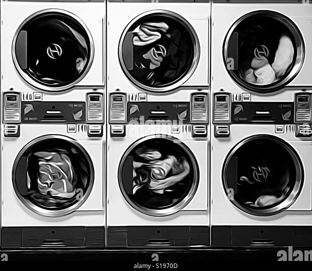 Clothes tumbling dry at the laundromat in black and white - Stock-Bilder