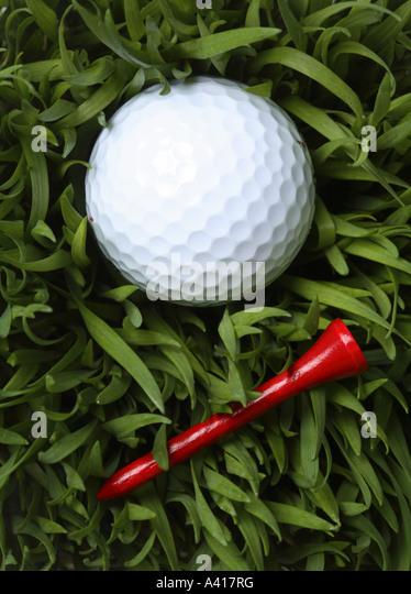 Golf Ball and Tee - Stock Image