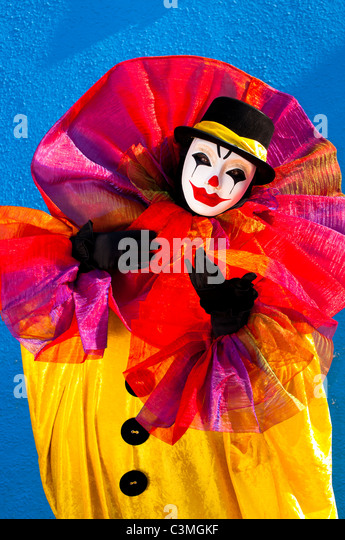 Clown dressed in colorful costume,Venice, Italy - Stock Image