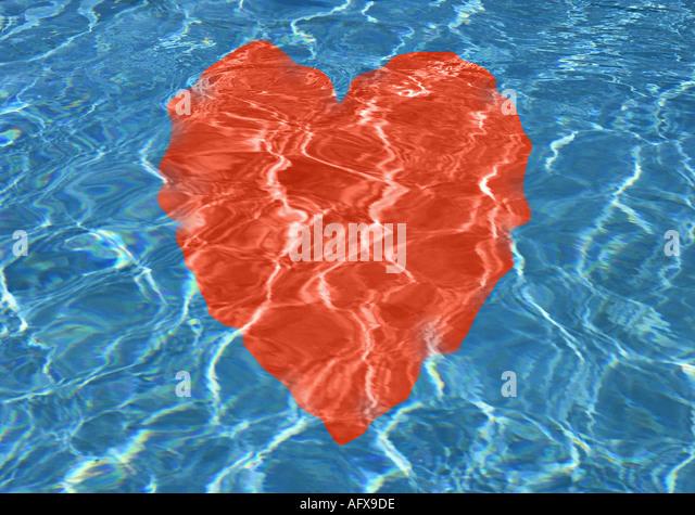 Red heart under water - Stock-Bilder