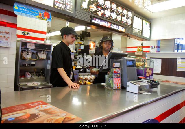 Nevada Las Vegas Sahara Avenue McDonald's fast food restaurant employee job behind counter teen boy Black girl - Stock Image