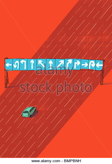Car paused before various road signs - Stock Image