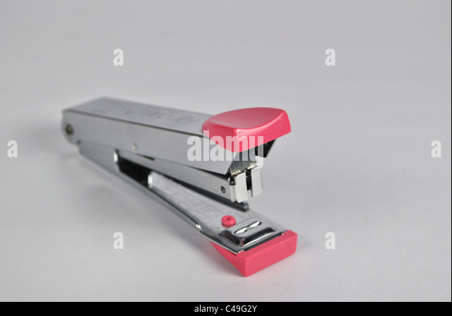 stapler office stationary pin adjoining grouping cut out cut-out silo white background metal plastic fiber shiny - Stock Image
