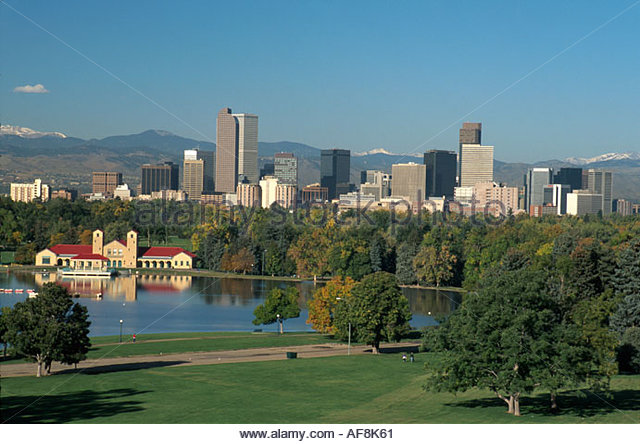 Colorado City Park Lake downtown skyline Rocky Mountains beyond - Stock Image