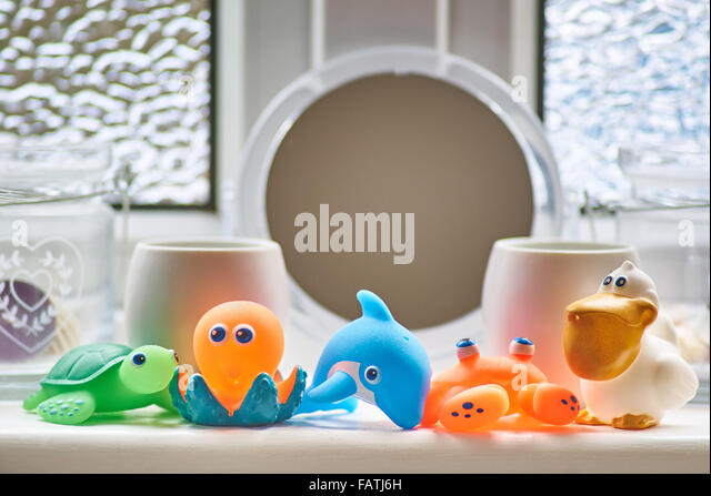 Mutlicoloured Bathroom toys - Stock Image