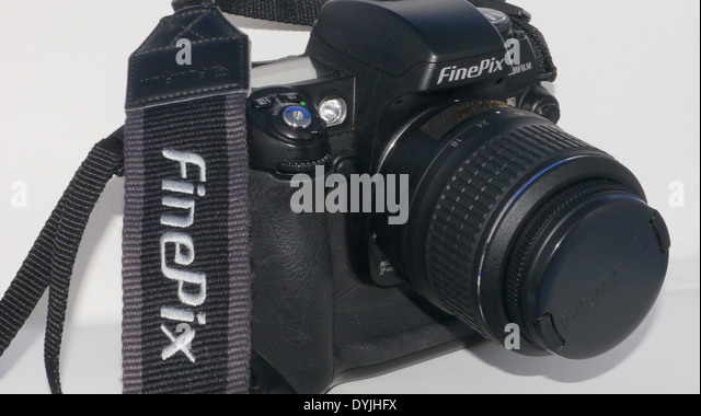 Fujifilm Finepix S3 pro DSLR camera with lens and strap, against white background - Stock Image