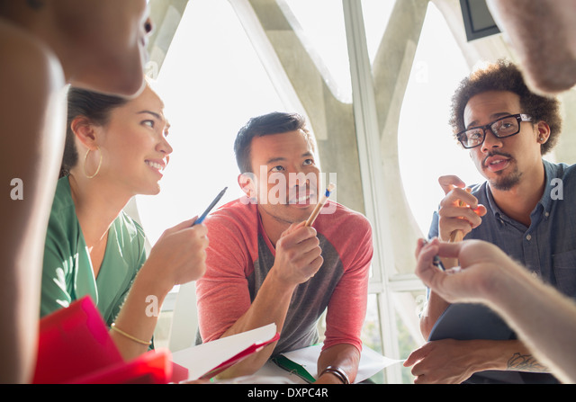 Creative business people brainstorming in circle - Stock Image