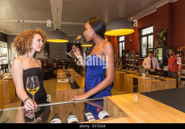 Happy hours at the wine house Enotavola-Casa del Barolo, Turin, Piedmont, Italy, Europe - Stock Image
