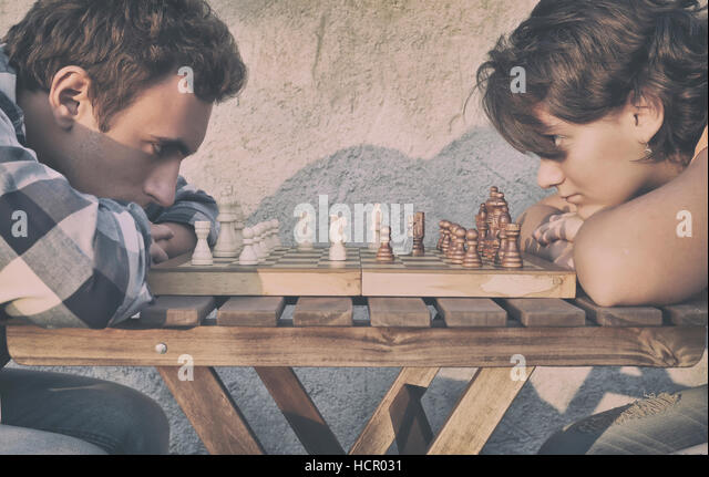 Man and girl playing chess - Stock Image