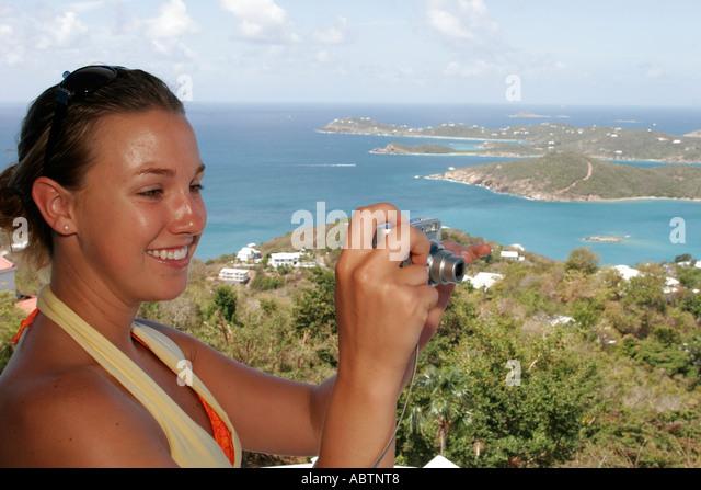 St. Thomas USVI Paradise Point female takes photo Charlotte Amalie Harbor Caribbean Sea - Stock Image