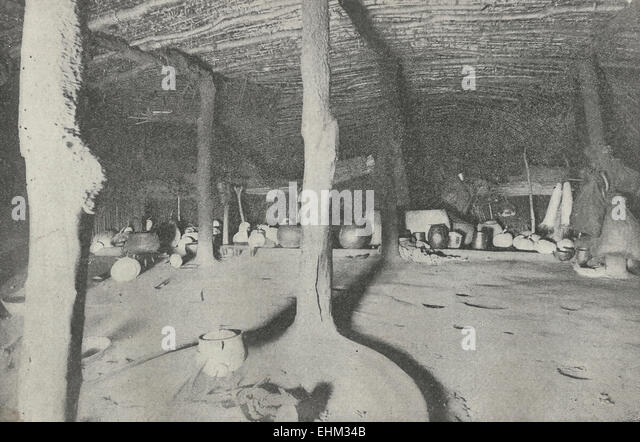 Interior of Native hut in South Africa - Large size with some skins and weapons of war, circa 1898 - Stock Image
