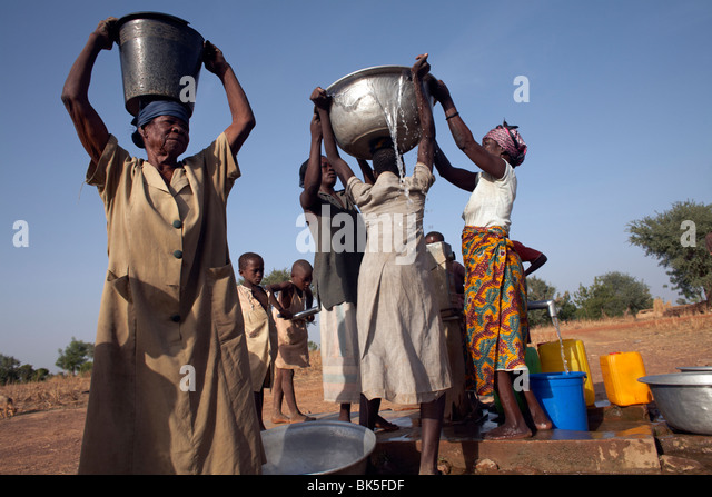 Villagers collect water near Nandom, Ghana, West Africa, Africa - Stock Image