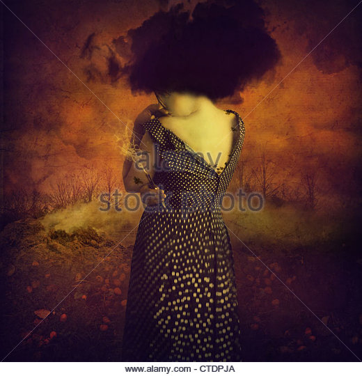 The day She Burnt Bad memories,woman with a burnt match in her hand - Stock Image