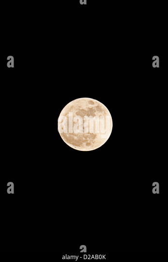 Moon illuminated in night sky - Stock Image