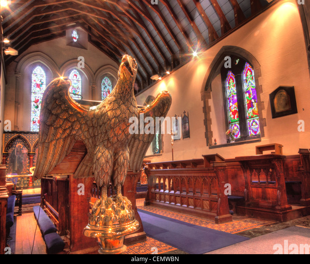 All Saints Church Thelwall, South Warrington, Cheshire England UK United Kingdom. Anglican Religion Brass eagle - Stock Image