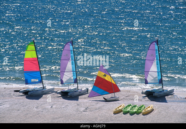 Marco Island FL Florida Southwest Florida Naples area sailboats and kayaks on beach - Stock Image
