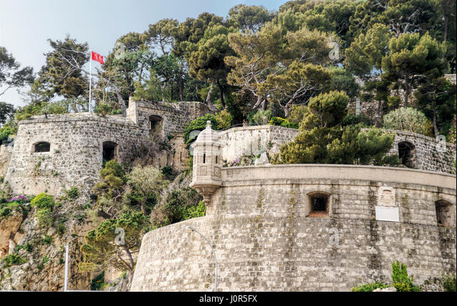 Medieval fortress that surrounds the Prince's Palace in Monte Carlo, Principality of Monaco - Stock Image