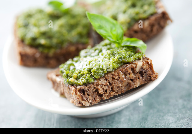 whole grain bread with fresh basil pesto - Stock Image
