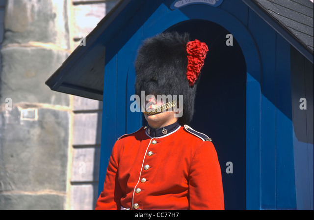 The Citadel military guard in red coat at attention in front of guard house in Quebec City, Canada - Stock Image