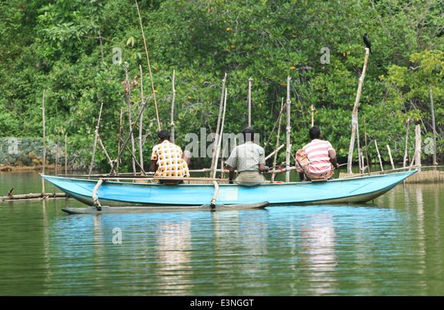 Drei Fischer auf dem Wasser - Stock-Bilder