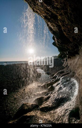 Waterfall at sunset on Sandcut Beach - Jordan River Regional Park - near Sooke, Vancouver Island, British Columbia, - Stock Image