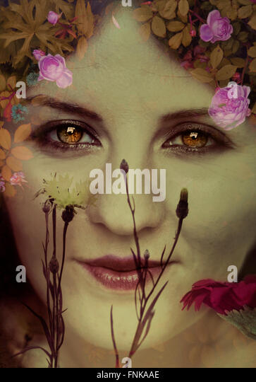 surreal portrait of the woman in flowers - Stock Image