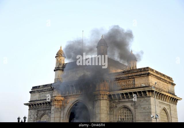 Explosion Fire Smoke Gateway of india at mumbai maharashtra India - Stock Image