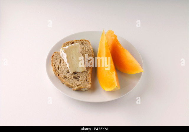 Melon and slice of bread with camembert - Stock Image
