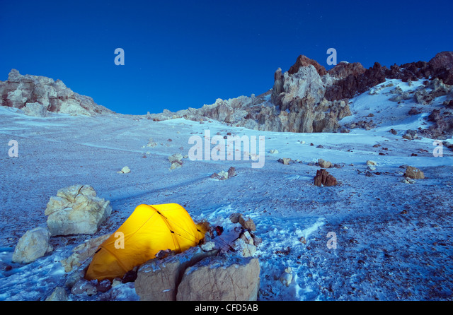 Illuminated tent at White Rocks campsite, Piedras Blancas, Aconcagua Provincial Park, Andes mountains, Argentina - Stock Image