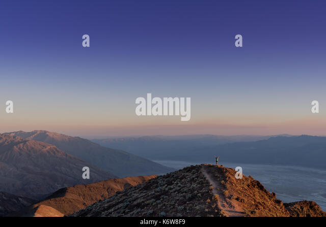 Wide View of Woman Stretching in Death Valley - Stock Image