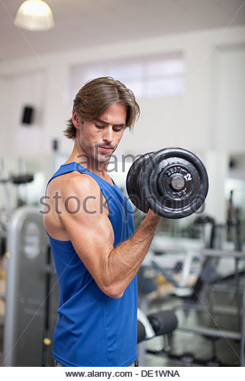 Man holding dumbbell - Stock Image