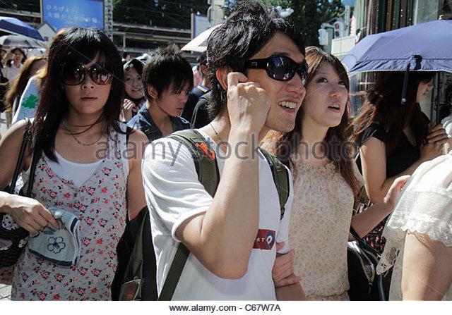 Japan Tokyo Harajuku Takeshita Dori Street shopping shoppers group crowd Asian teen girl boy - Stock Image