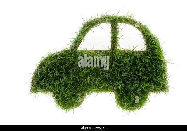 Car symbol made from grass, close-up - Stock Image