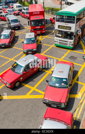 Busy traffic near the Central Ferry Piers in Central, Hong Kong, China - Stock Image