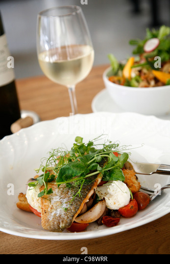 Fish and Salad dishes at the upmarket Mizlala restaurant, belonging to chef Meir Adoni, Tel Aviv, Israel. - Stock Image