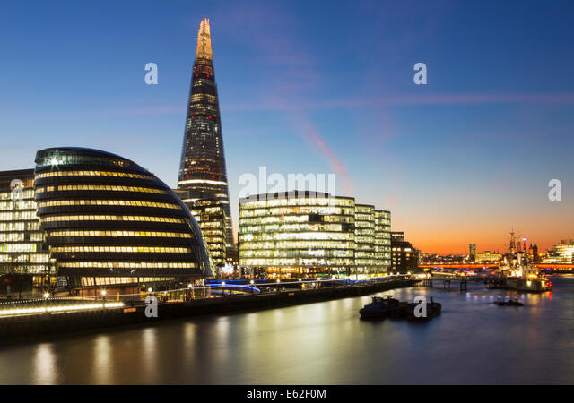 The Shard, City Hall and buildings on Southbank of River Thames at dusk, London, England - Stock Image