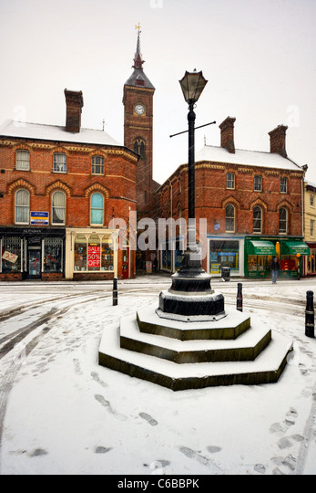 Louth, Lincolnshire, England in the winter snow, snowing, footprint in the market square - Stock Image