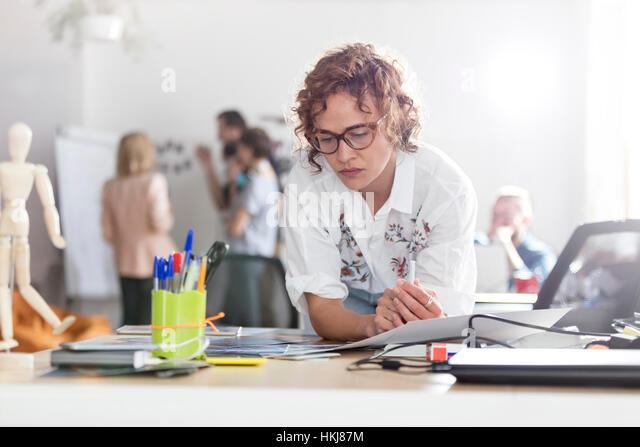 Focused female design professional planning in office - Stock-Bilder